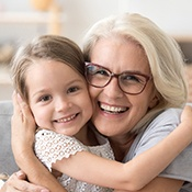 woman smiling with grandchild
