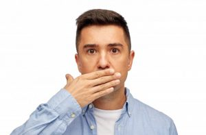 A man covering his mouth.