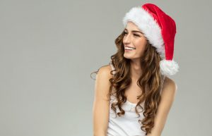 Girl wearing a Santa hat and smiling